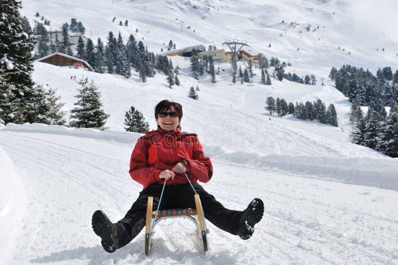 Download Senior Woman On Sledge Having Fun Stock Photo - Image: 10959532