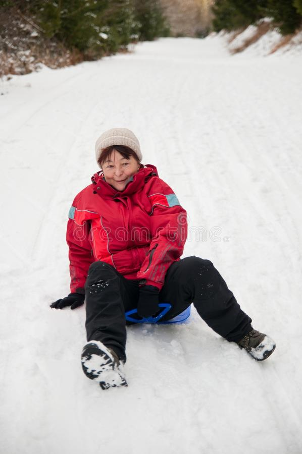 Download Senior Woman On Sledge - Winter Snow Activity Stock Photography - Image: 27067802