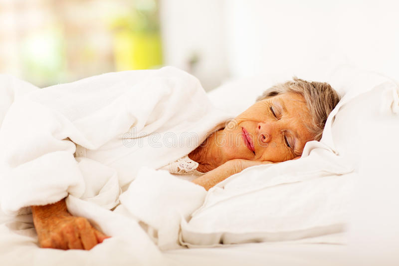 Senior woman sleeping royalty free stock photos
