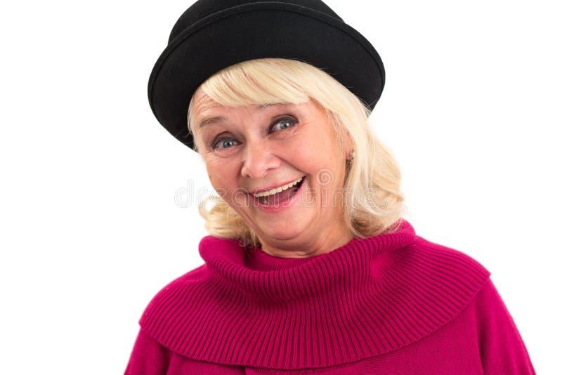 Senior woman is smiling. Cheerful lady on white background stock photos