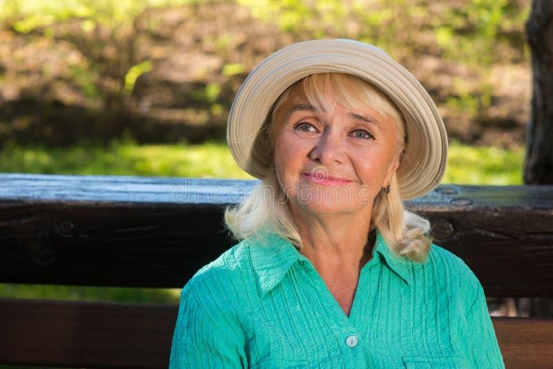 Senior woman is smiling. royalty free stock photos