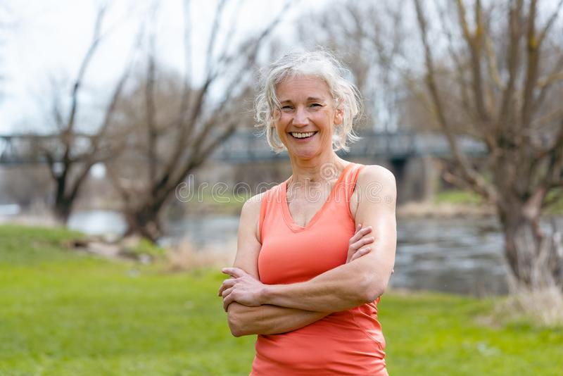 Senior woman in sport clothes looking at camera royalty free stock image