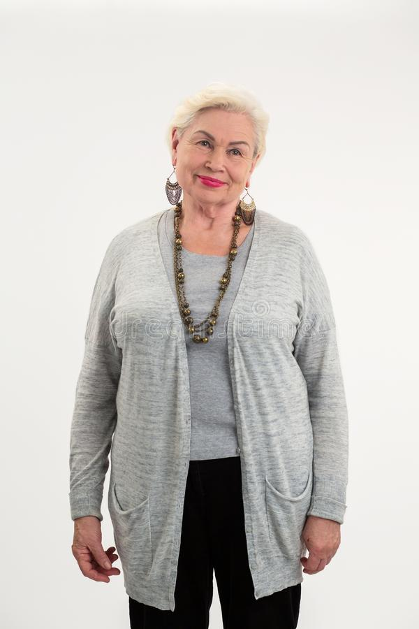 Senior woman standing isolated. stock image