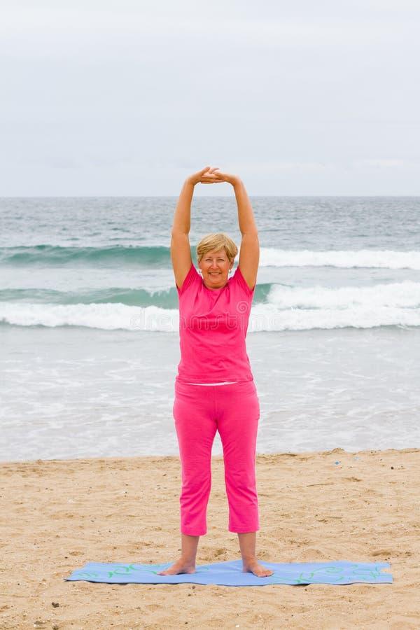 Senior woman stretching royalty free stock photos