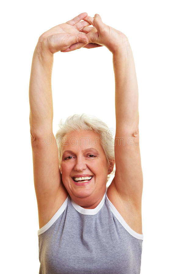 Senior woman stretching her arms royalty free stock image