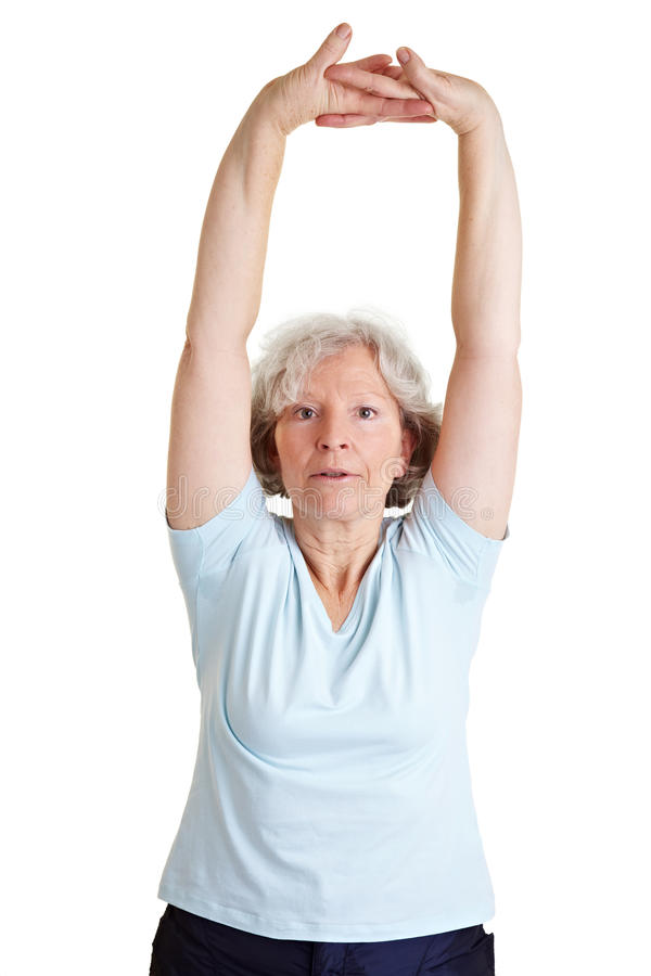 Download Senior Woman Stretching Her Arms Stock Photo - Image of female, retiree: 18778372