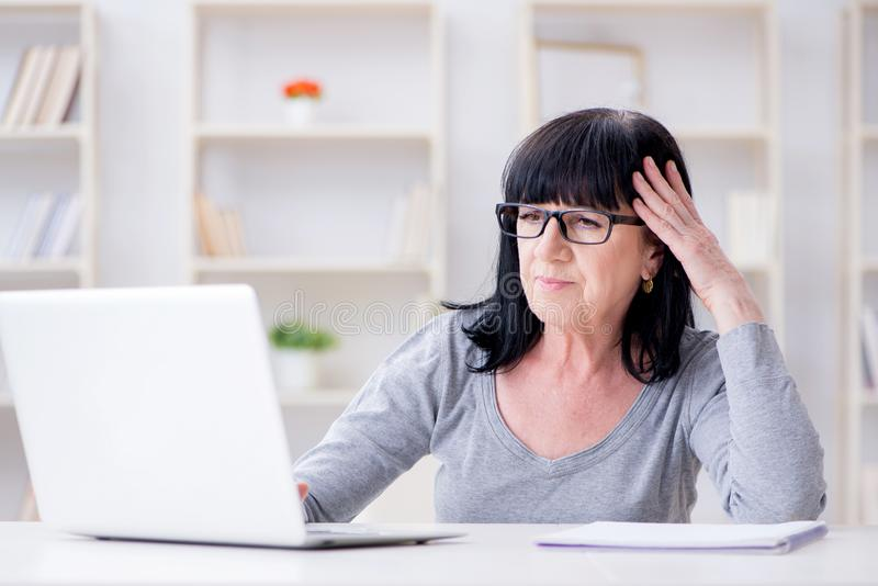 The senior woman struggling at computer stock photography