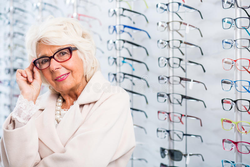 Senior woman in stylish eyeglasses. Portrait of senior woman in stylish eyeglasses royalty free stock photos