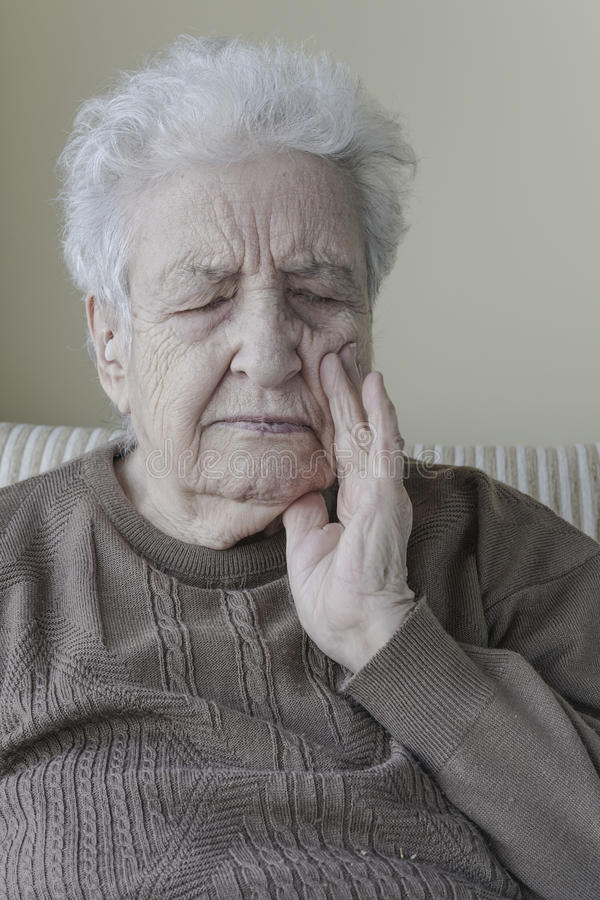 Senior woman suffering pain royalty free stock images