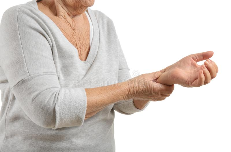 Senior woman suffering from pain in wrist on white background stock images