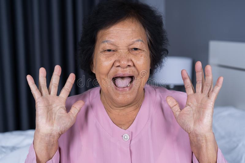 Senior woman with surprised expression stock image