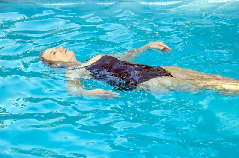 Download Senior woman swimming stock photo. Image of workout, active - 12785962