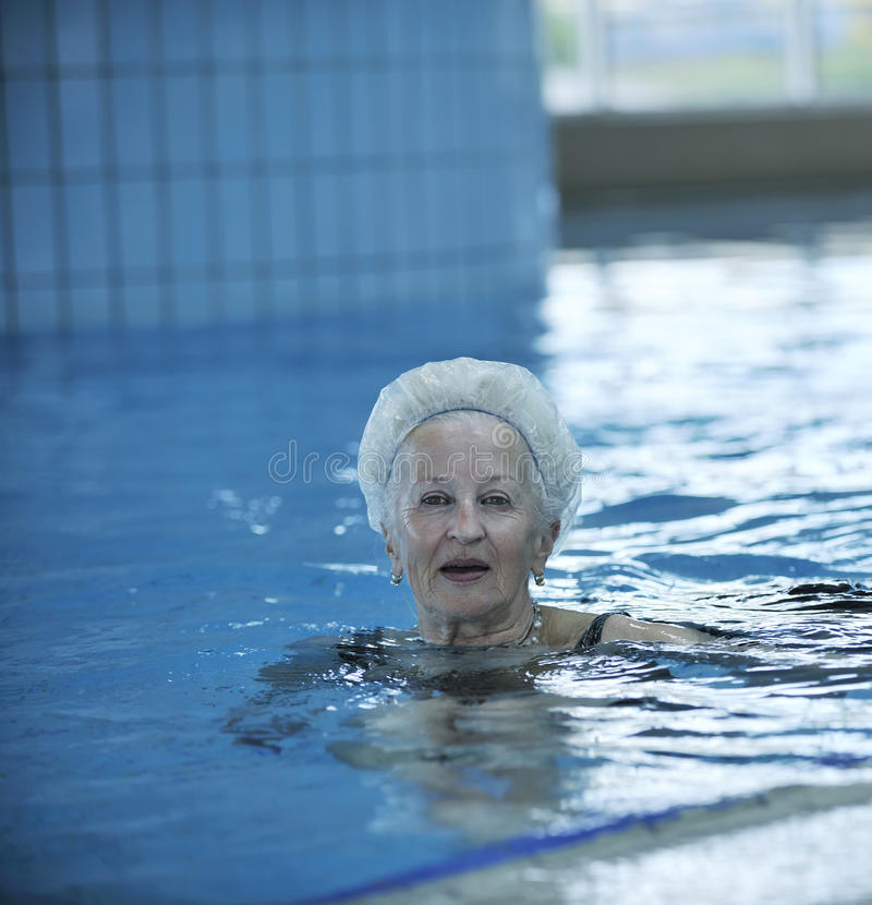Senior woman at swimming pool royalty free stock photography