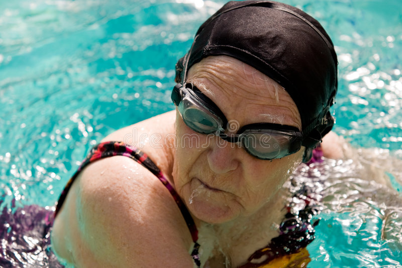 Senior Woman Swimming in a pool stock photo