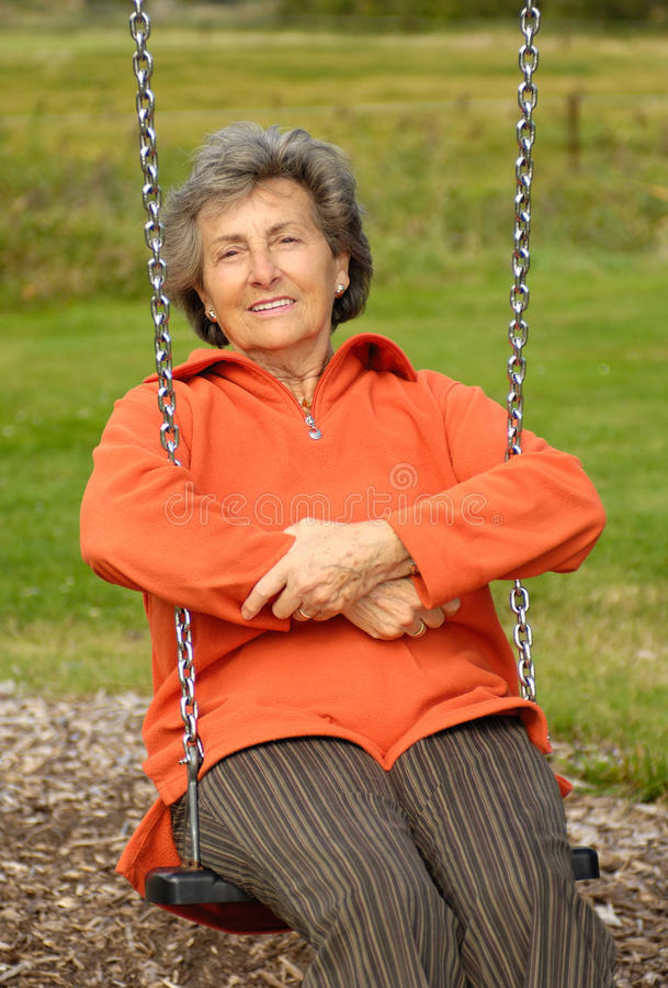 Senior woman on a swinger royalty free stock images