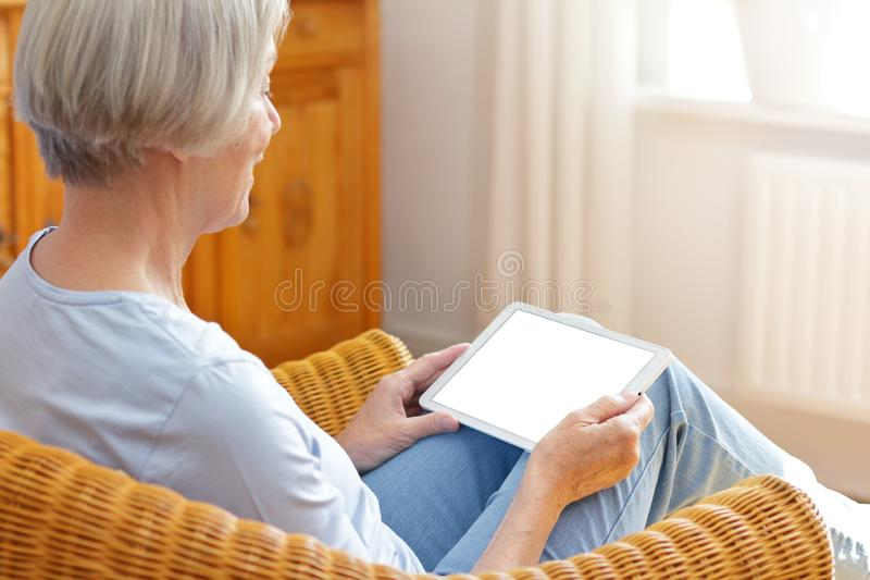 Senior woman tablet computer home royalty free stock images