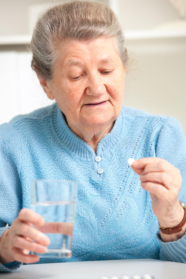 Free Senior Woman Taking Her Medicine Stock Photos - 32203183