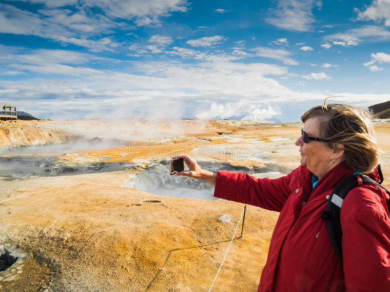 Senior woman is taking a picture at a boiling mud stock photos