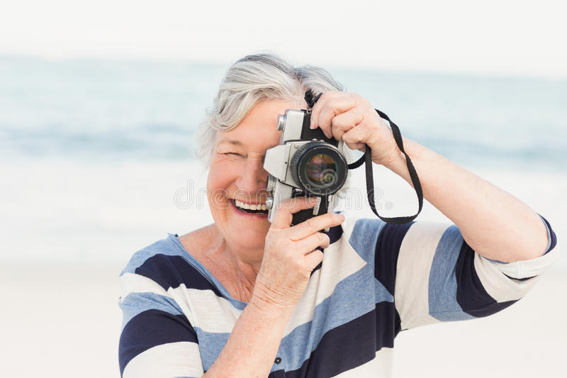 Senior woman taking picture royalty free stock image