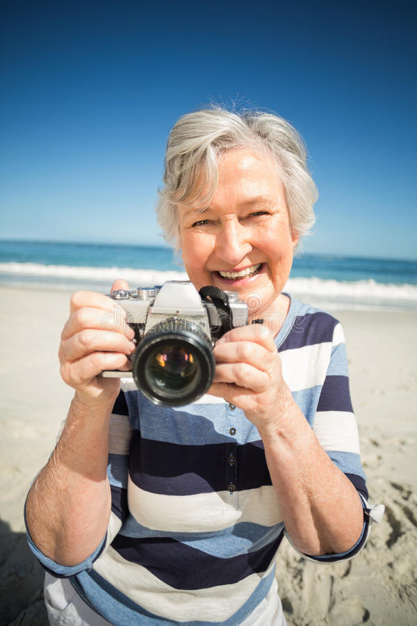Senior woman taking picture royalty free stock photo