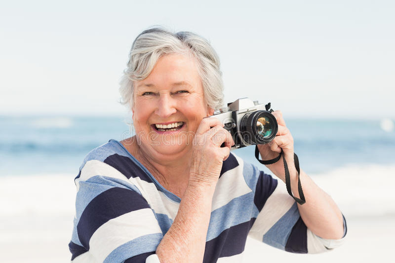 Senior woman taking picture stock images