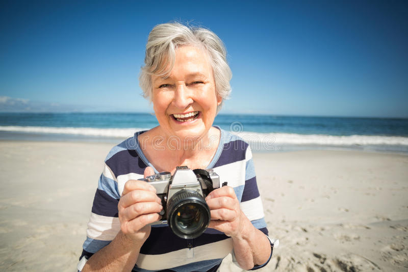 Senior woman taking picture royalty free stock photos