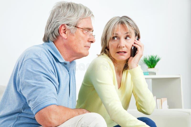 Senior woman talking on cell phone royalty free stock photo