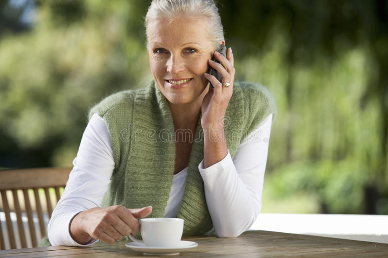 A senior woman talking on a mobile phone royalty free stock image