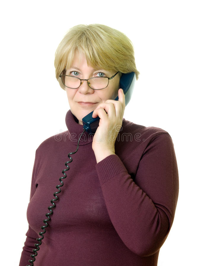 A senior woman at telephone royalty free stock image