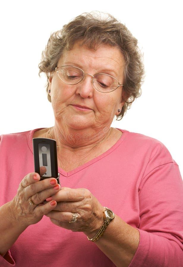 Senior Woman Texting on Cell Phone stock photos