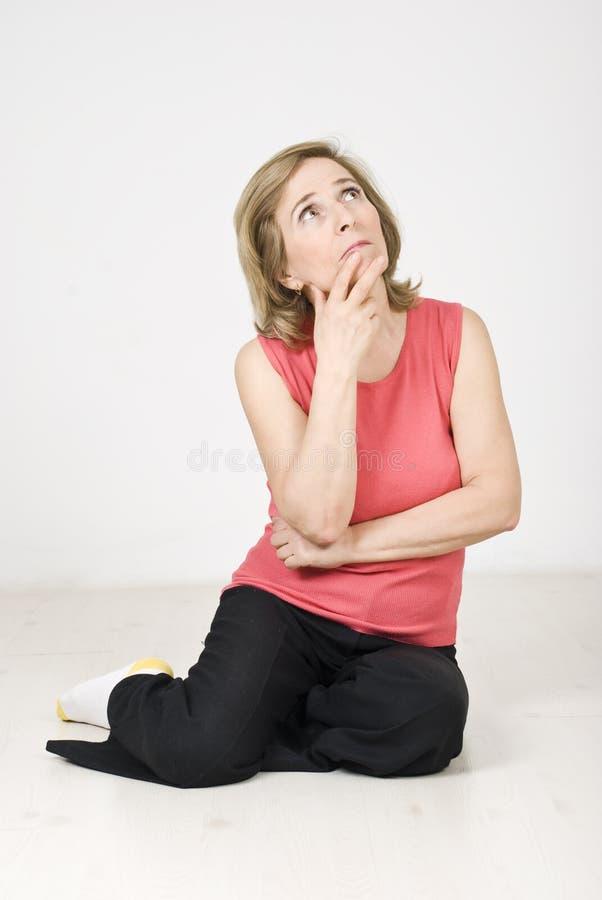Senior woman thinking stock photo