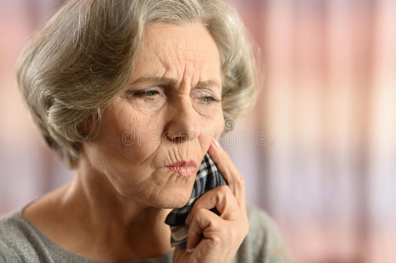 Senior woman with tooth pain royalty free stock image