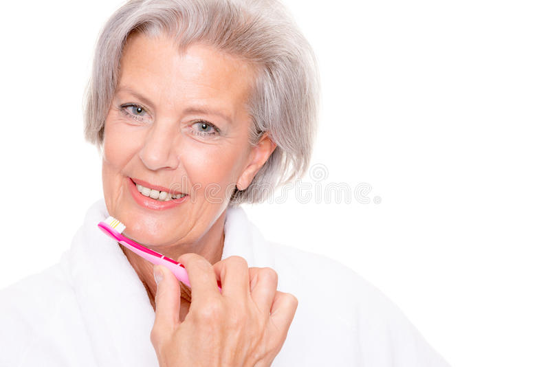 Senior woman with toothbrush royalty free stock image