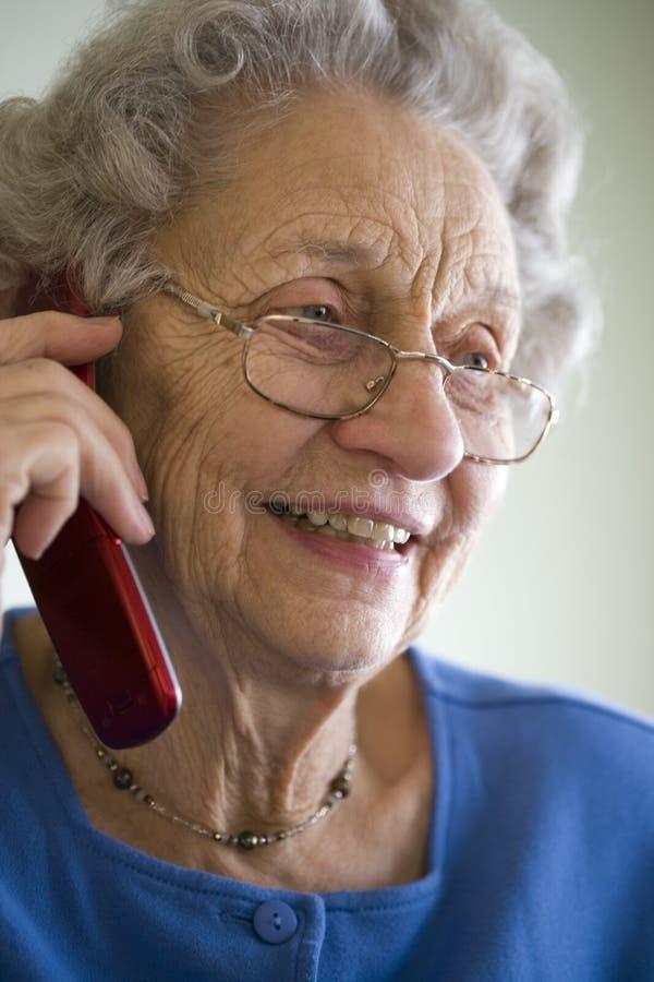 Senior woman using cell phone royalty free stock photos