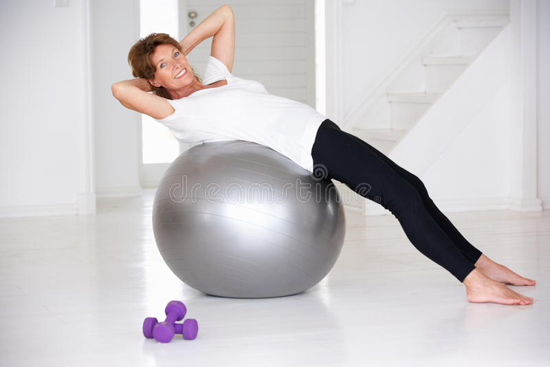 Download Senior Woman Using Gym Ball Stock Image - Image: 21050841