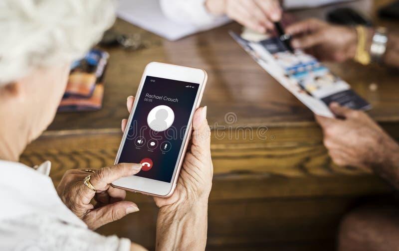 Senior woman using her phone stock photo