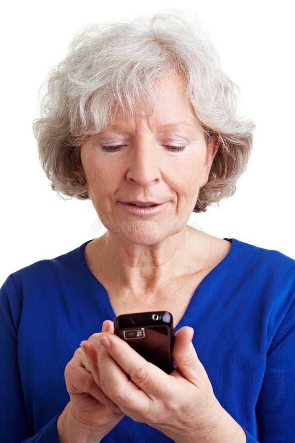 Senior woman using internet royalty free stock photography