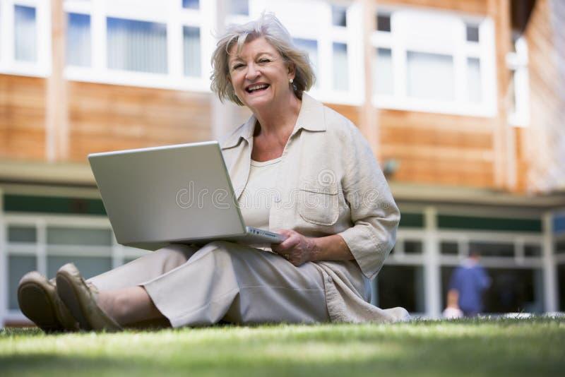 Senior Woman Using Laptop On Campus Stock Photos