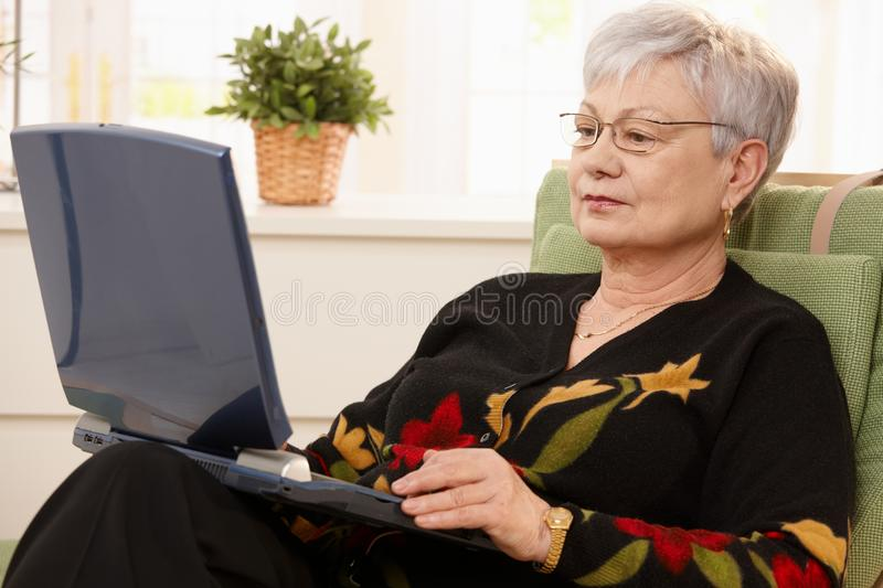 Download Senior Woman Using Laptop Computer Stock Image - Image: 18216757