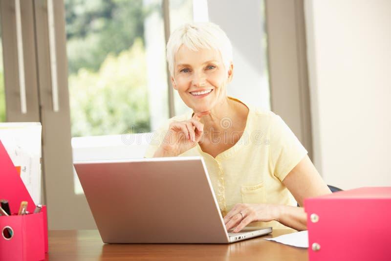 Download Senior Woman Using Laptop At Home Stock Image - Image: 14884987