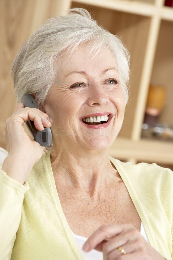 Senior Woman Using Phone At Home royalty free stock photos
