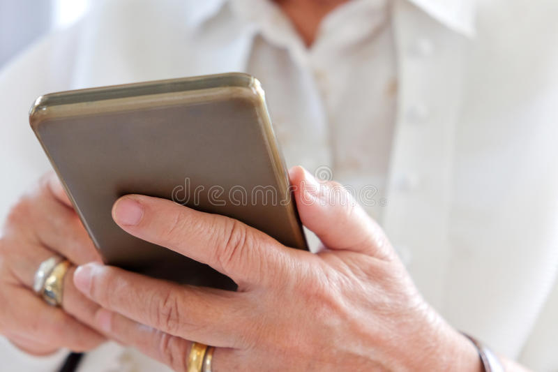 Senior woman using smart phone royalty free stock photo