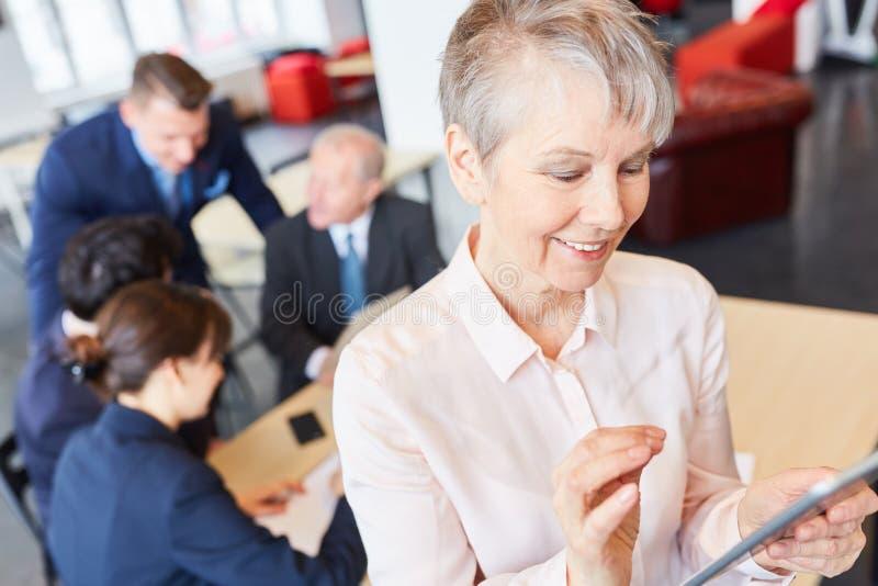 Senior woman using tablet computer royalty free stock photo