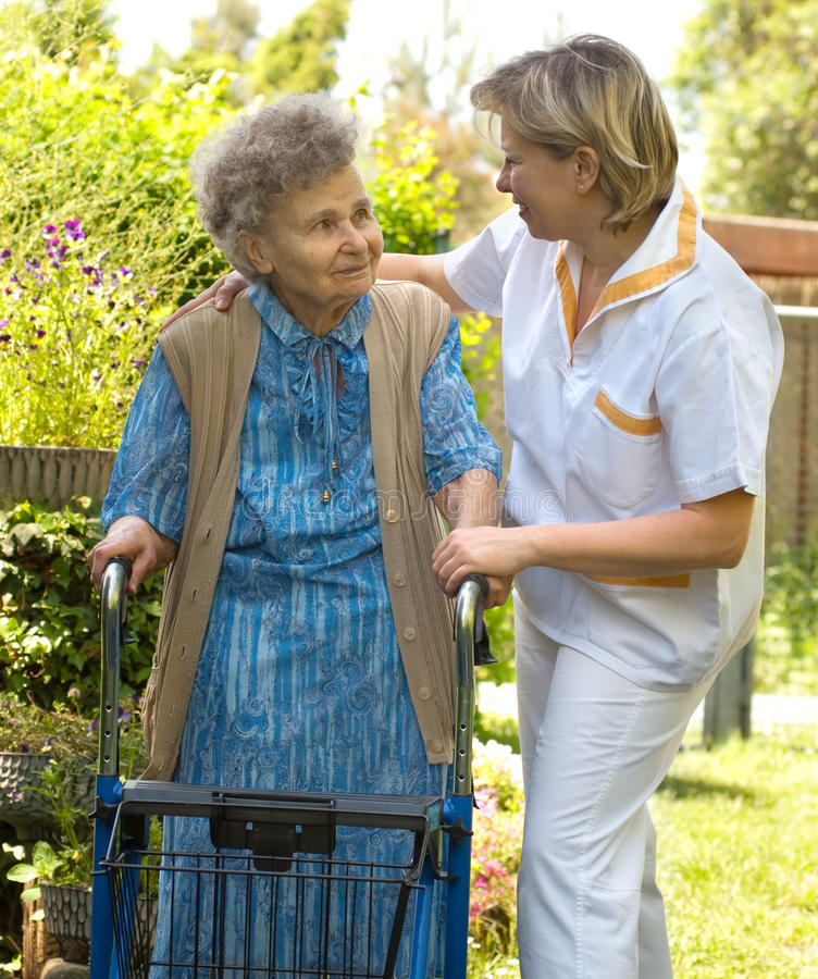 Download Senior woman walking stock photo. Image of caregiver, care - 9841828