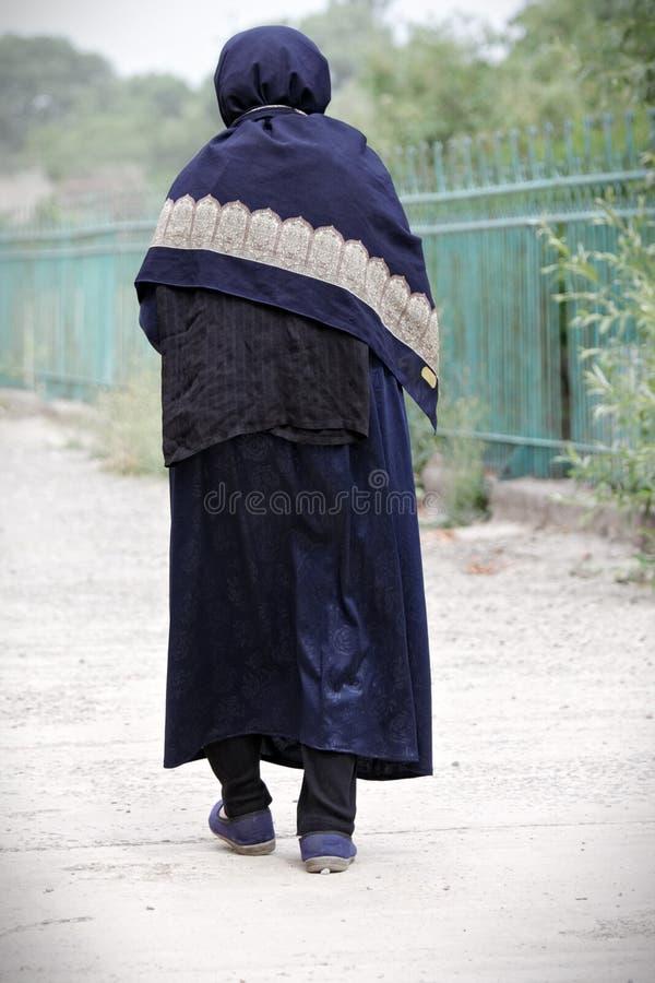 Senior woman walking away royalty free stock photo