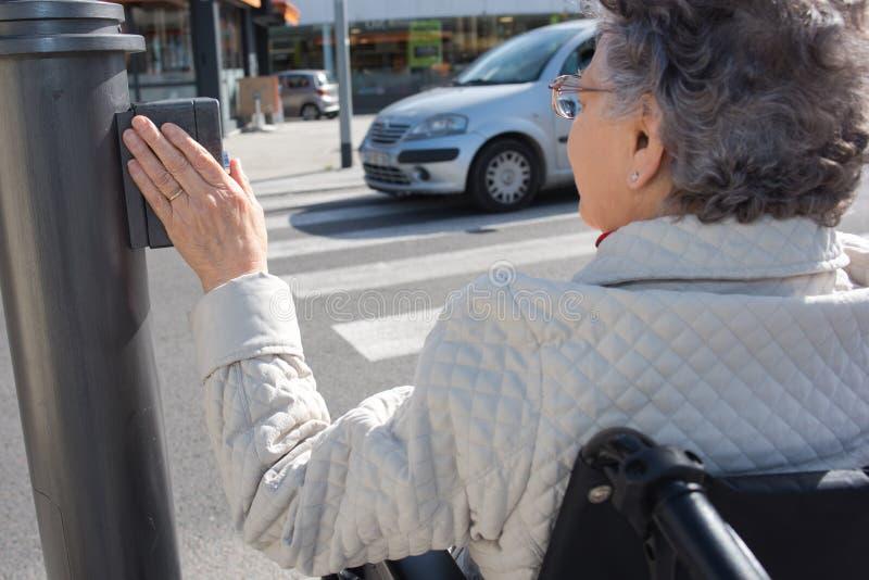 Senior woman wants to cross street stock photography