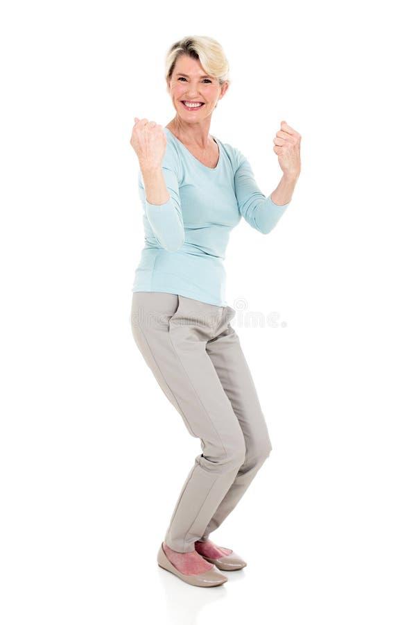 Senior woman waving fists stock photography