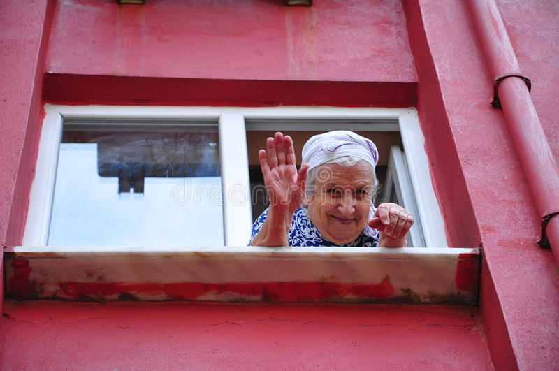 Senior woman waving her hand royalty free stock images