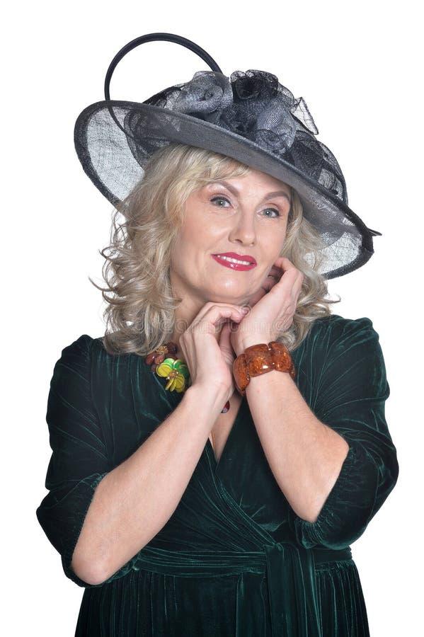 Senior woman wearing black hat isolated on white background stock photography
