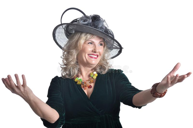 Senior woman wearing black hat isolated on white background stock photo